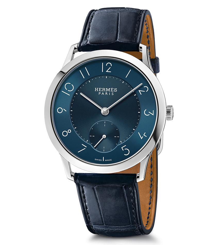 Slim d'Hermès 圓潤纖薄的錶殼,簡約的時間顯示,Philippe Apeloig獨創的字體讓畫面更加唯美。定價NT$ 254,400。